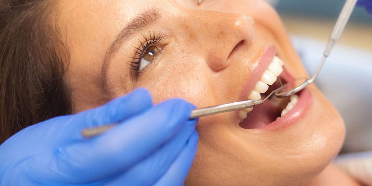 Closeup of Teeth with Dental Mirror